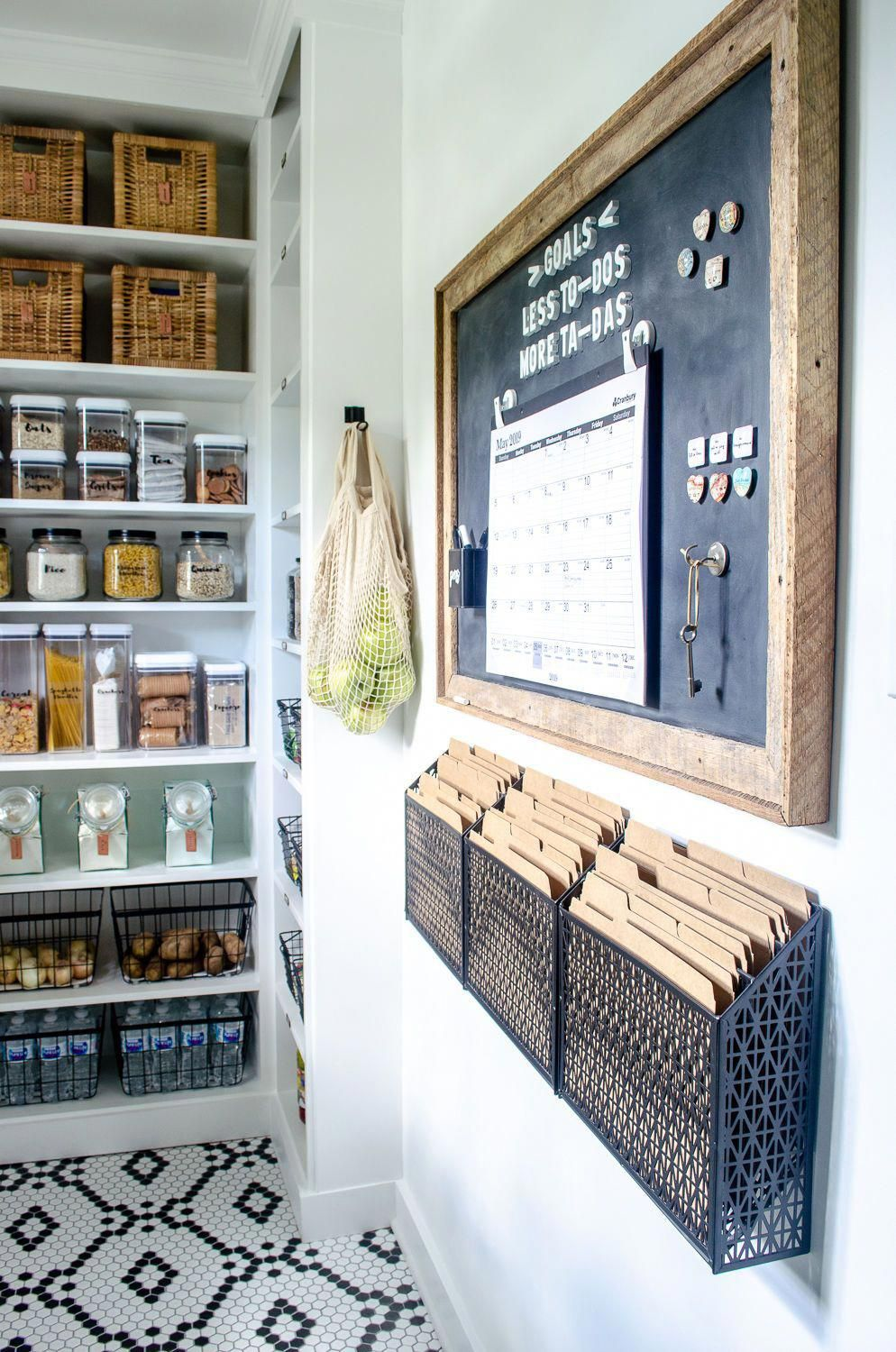 Walk in pantry organization idea using a magnetic board and command center. Loving all of the organization, pantry shelving, countertops, window garden...love it all! Narrow walk in pantry design with countertop and shelving #pantry #pantrygoals #pantryorganization #pantrydesign #kitchenorganization