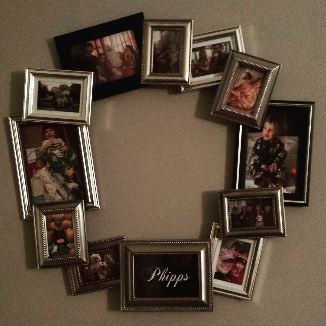 Now that it's finally hung up - I can post a photo! A family photo wreath done for xmas. Such fun to layout and make! :) #crafting #photos #phippsphamilyphotos by caitodorable