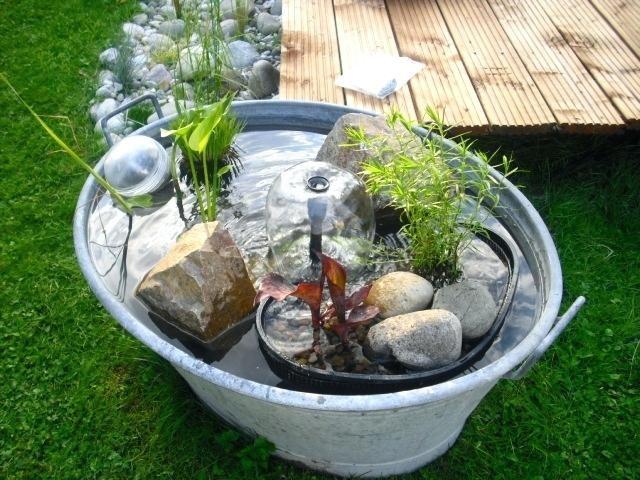 hnliches foto garten zinkwanne bepflanzen miniteich und zinkwanne teich. Black Bedroom Furniture Sets. Home Design Ideas