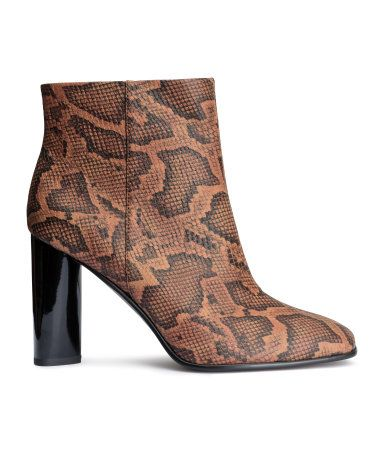 f9f38a93fbc Brown printed ankle boots in snakeskin-patterned imitation leather ...