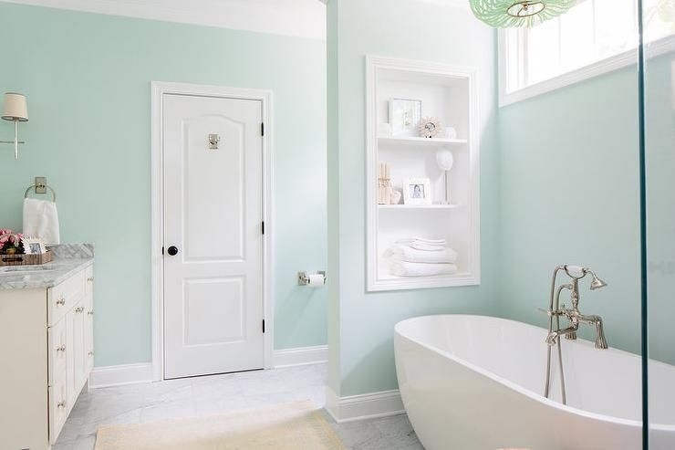 Green Spa Like Bathroom Features Walls Painted A Soothing Sherwin Williams Dewy Ed With Clerestory Window Over An Egg Shaped Tub Illuminated
