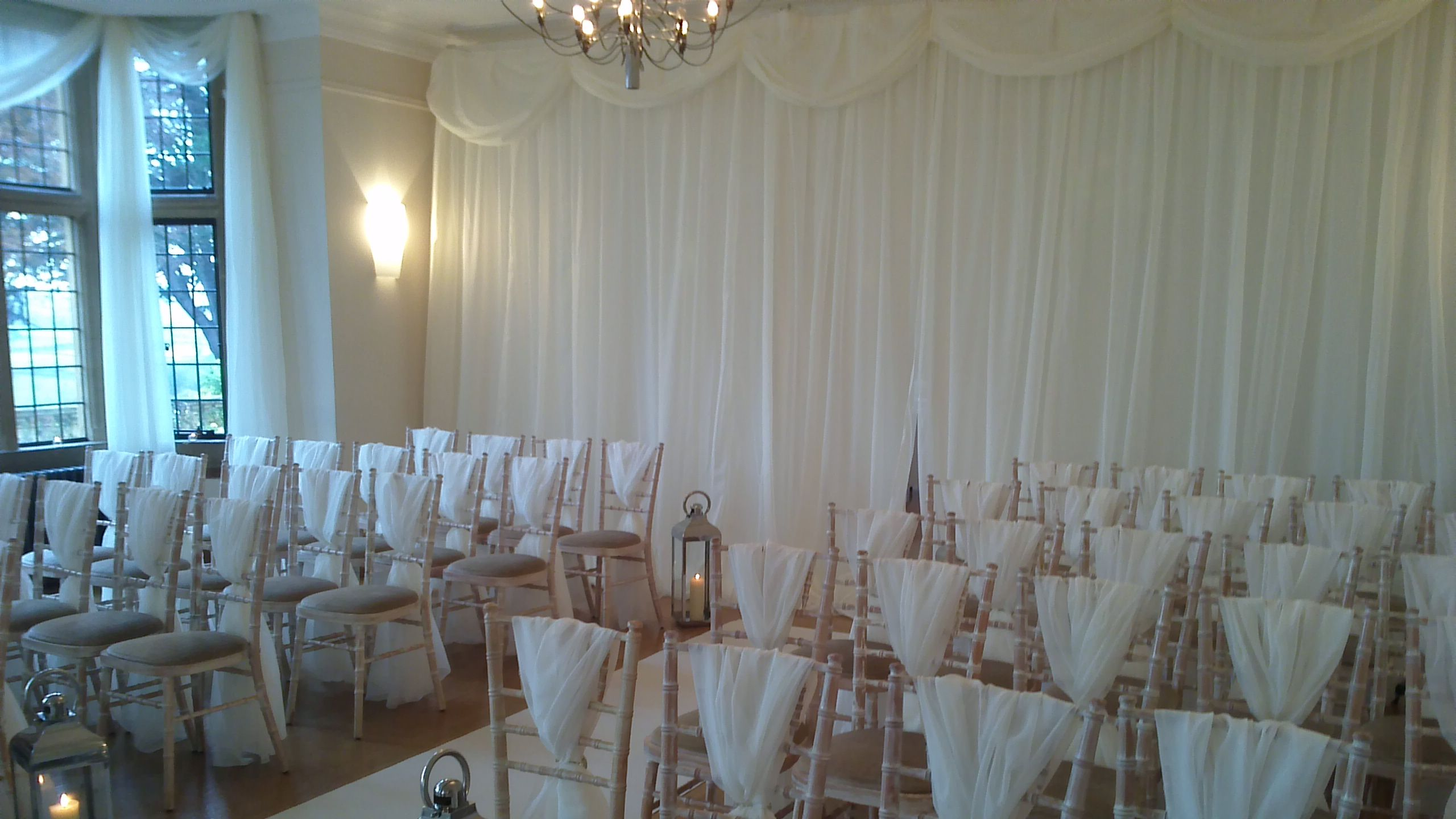Window and room divider drapes plus elegant chair covers from
