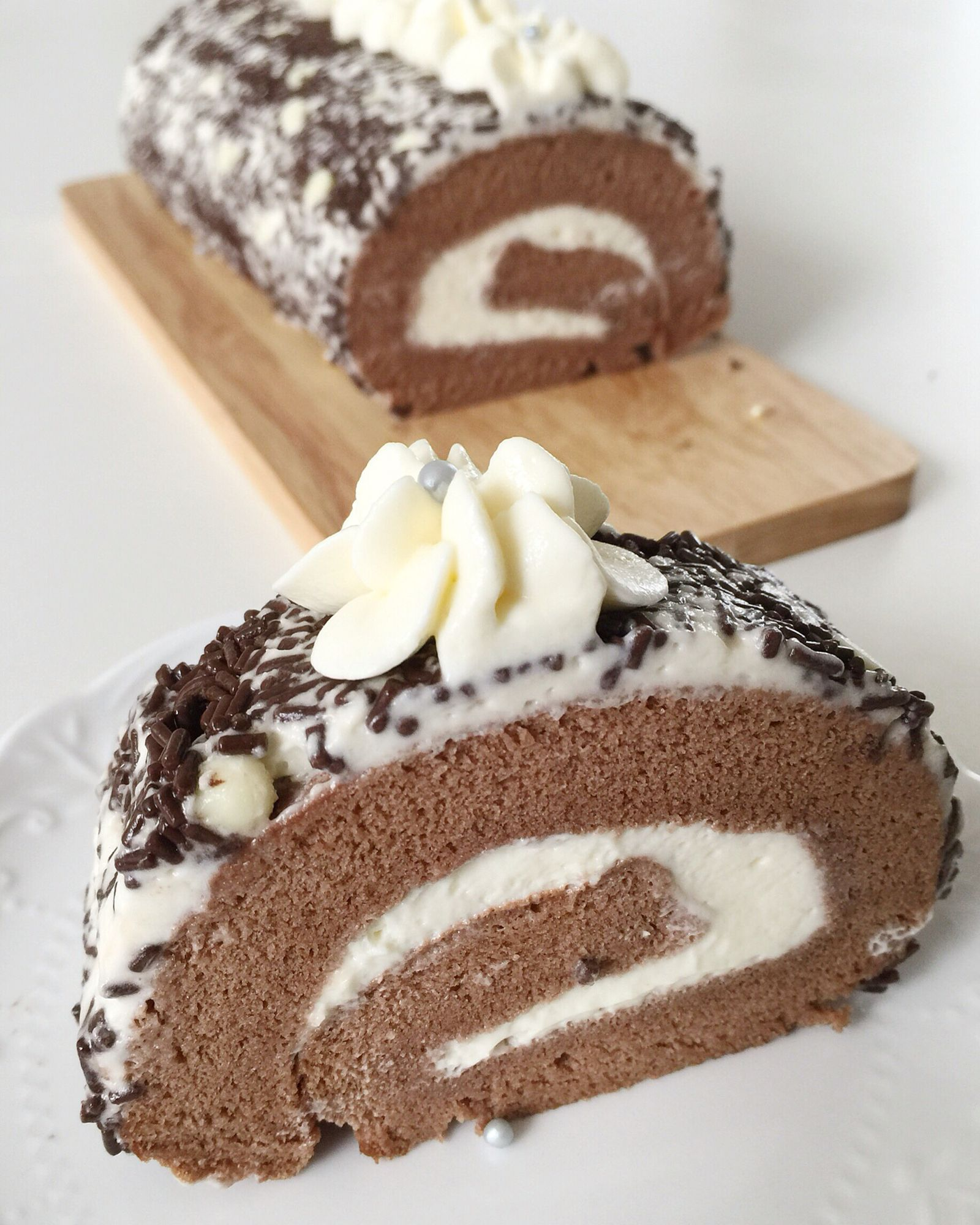 Old school chocolate swiss roll coated with chocolate rice