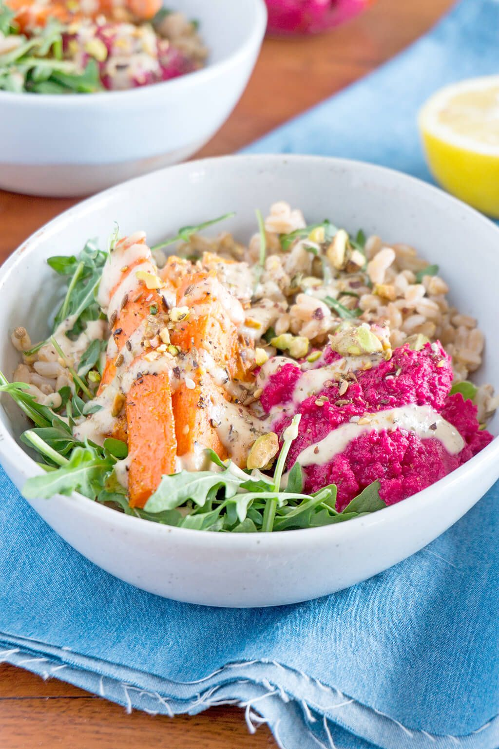 Packed with nutrients, this Farro Salad and Spiced Tahini Dressing is one of the most delicious vegetarian and vegan lunches I make. It's great for meal prep as well. #VEGETARIAN | #Recipes at www.OatandSesame.com