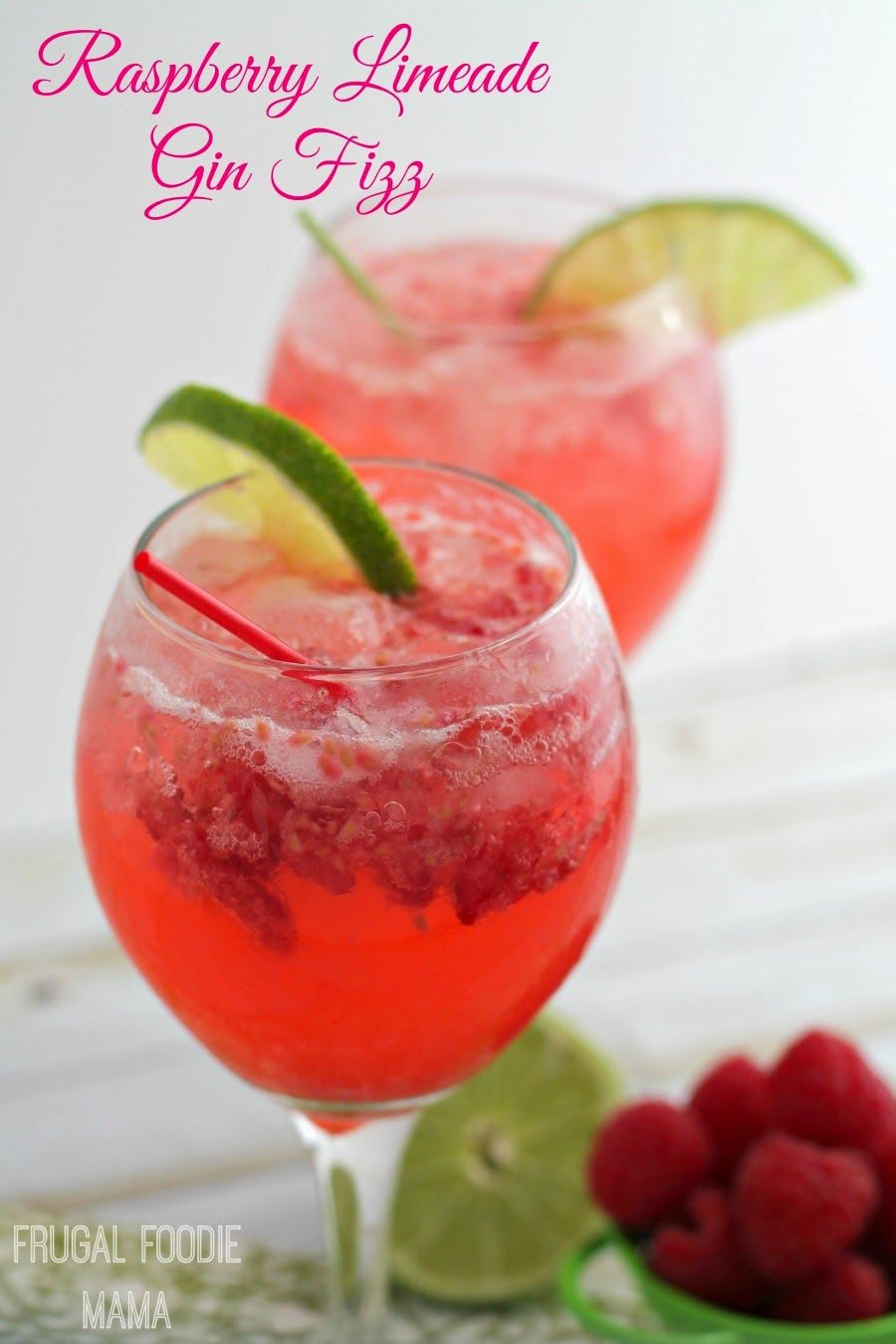 Fresh raspberries, lime, bubbly club soda, and a little gin come together in this perfect for spring Raspberry Limeade Gin Fizz