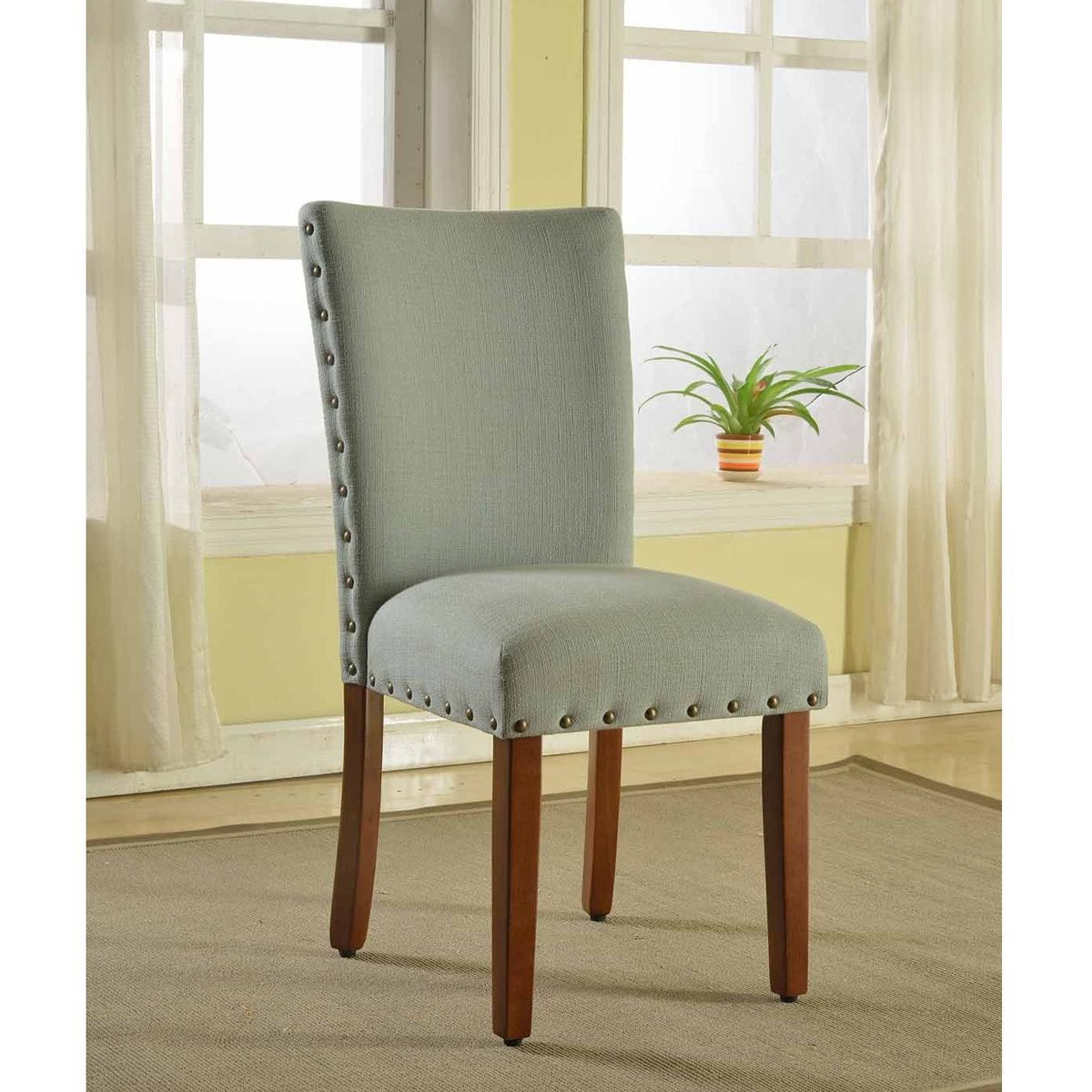 With this set of two sea foam green parsons chairs you can turn