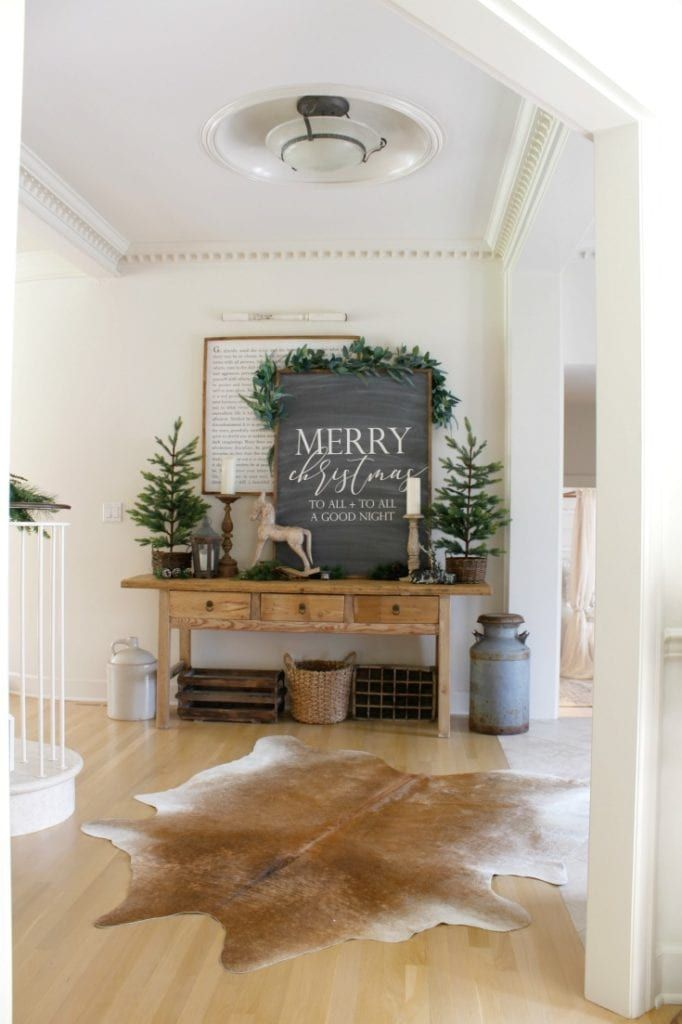 Learn our top 7 best designer tips to create a festive holiday home. My Christmas home tour showcases designer inspiration, easy & inexpensive decorating ideas, and our favorite shopping sources. #neutralchristmas #christmasdecor #farmhousestyle #vintagechristmas #thedesigntwins