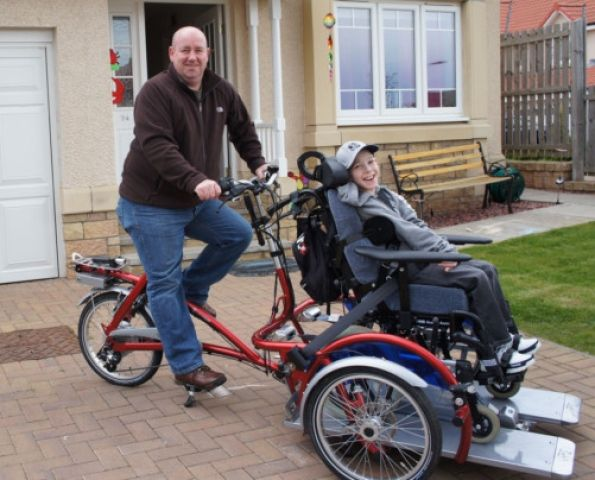 Caretaker Enjoying A Ride With A Disabled Person By