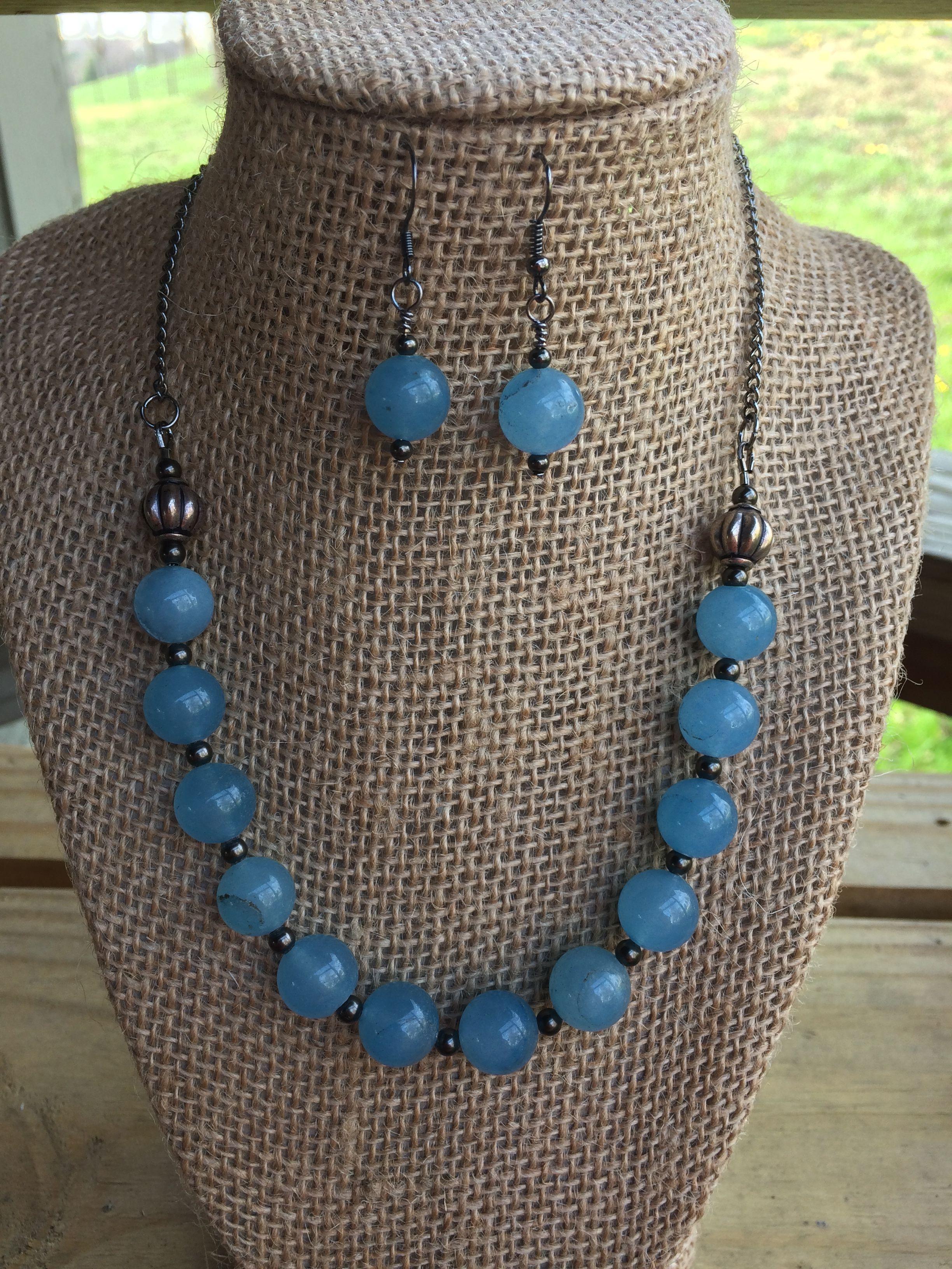 Tariza's light blue necklace.