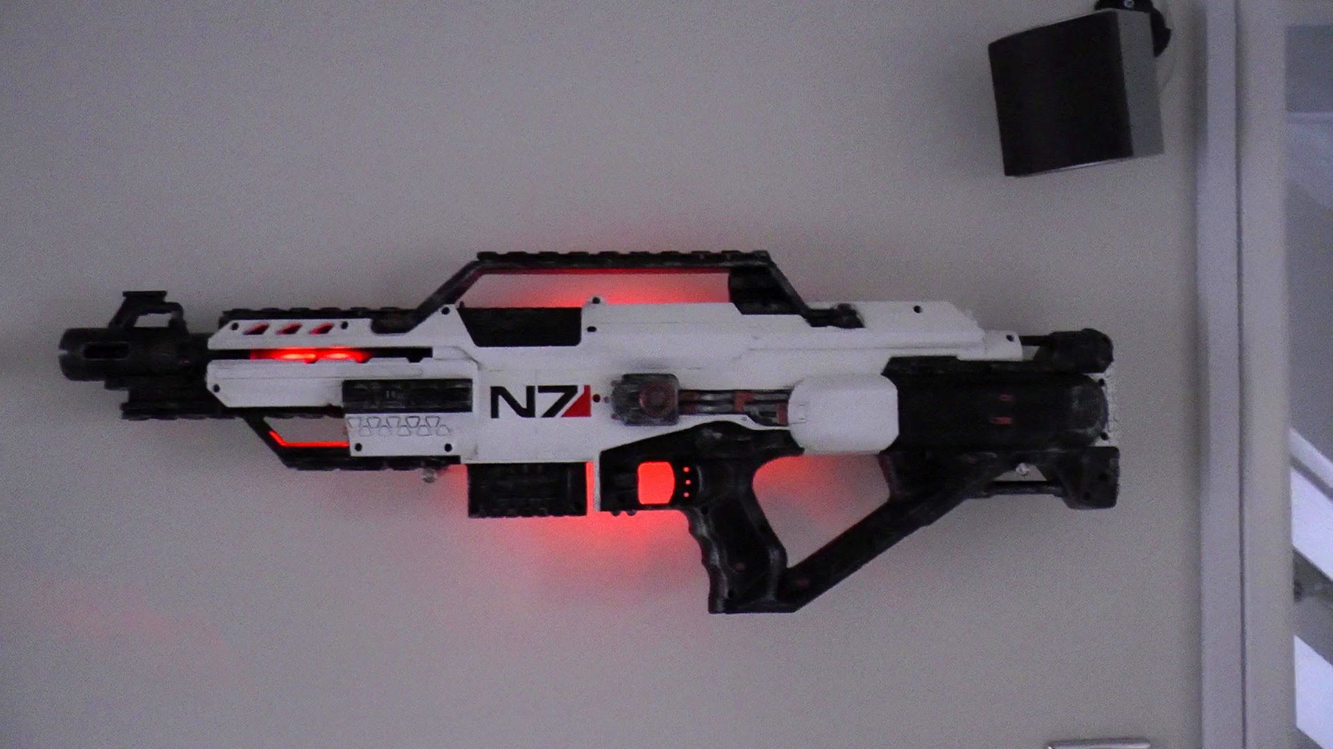 So my friend makes working Destiny/MassEffect/Warhammer replica weapons  from Nerf guns for a living.