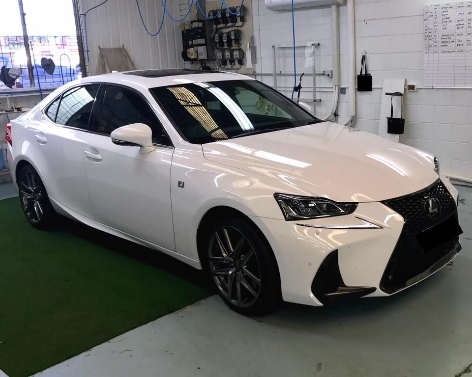 Black Window Tint Installed On A White Lexus Creates A Strong