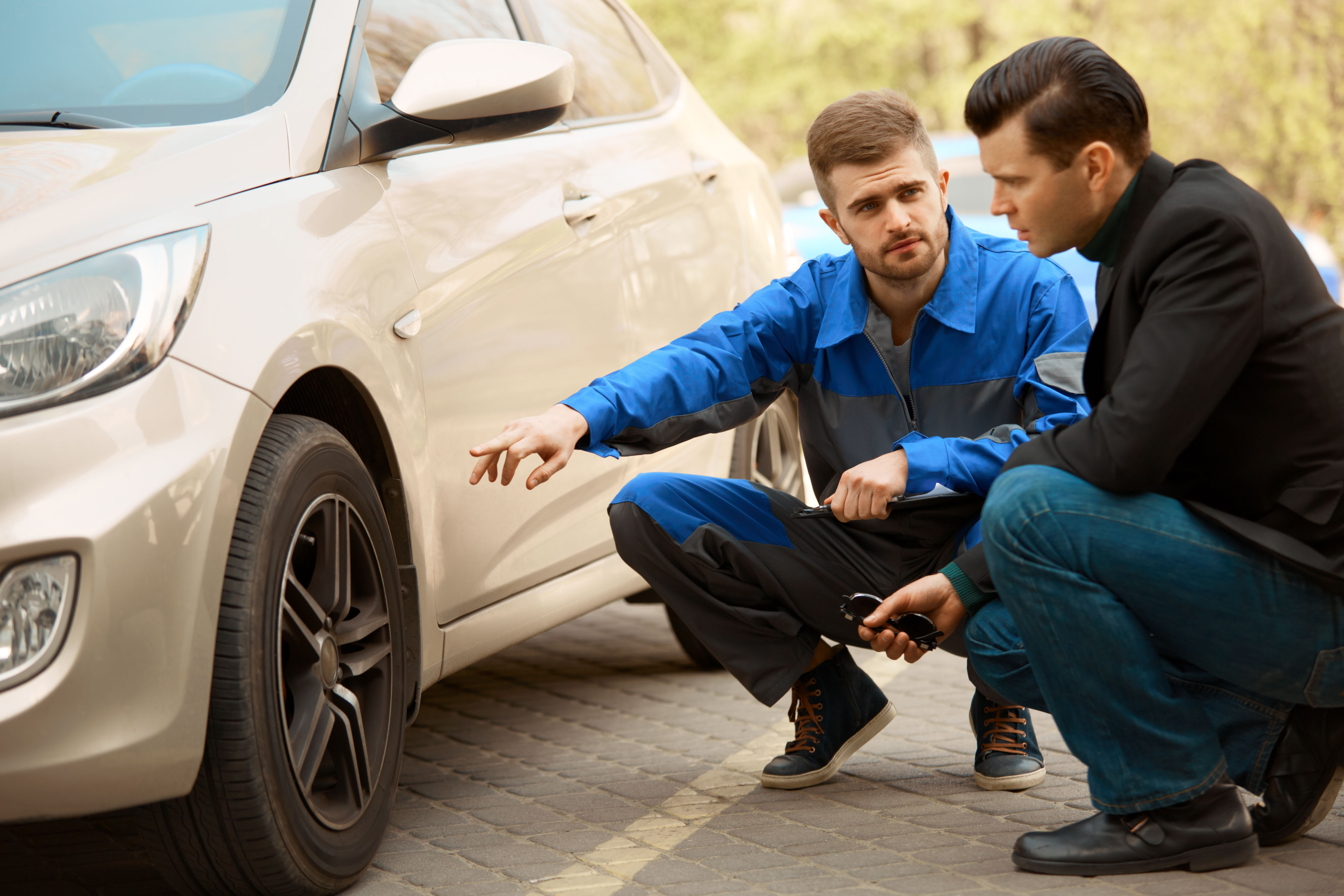 Mechanic And Customer Discussing Problem With Car Customer Auto Collision Repair Auto