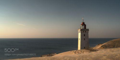 Mood at the lighthouse by LeifLndal  denmark sunrise sea sunset water beach travel sun light coast lighthouse ocean waves summer sand