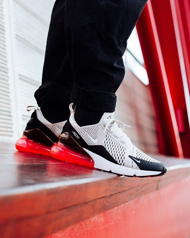 ee51e21967 The NIKE AIR MAX 270 LIGHT BONE AND HOT PUNCH makes a bold addition to any