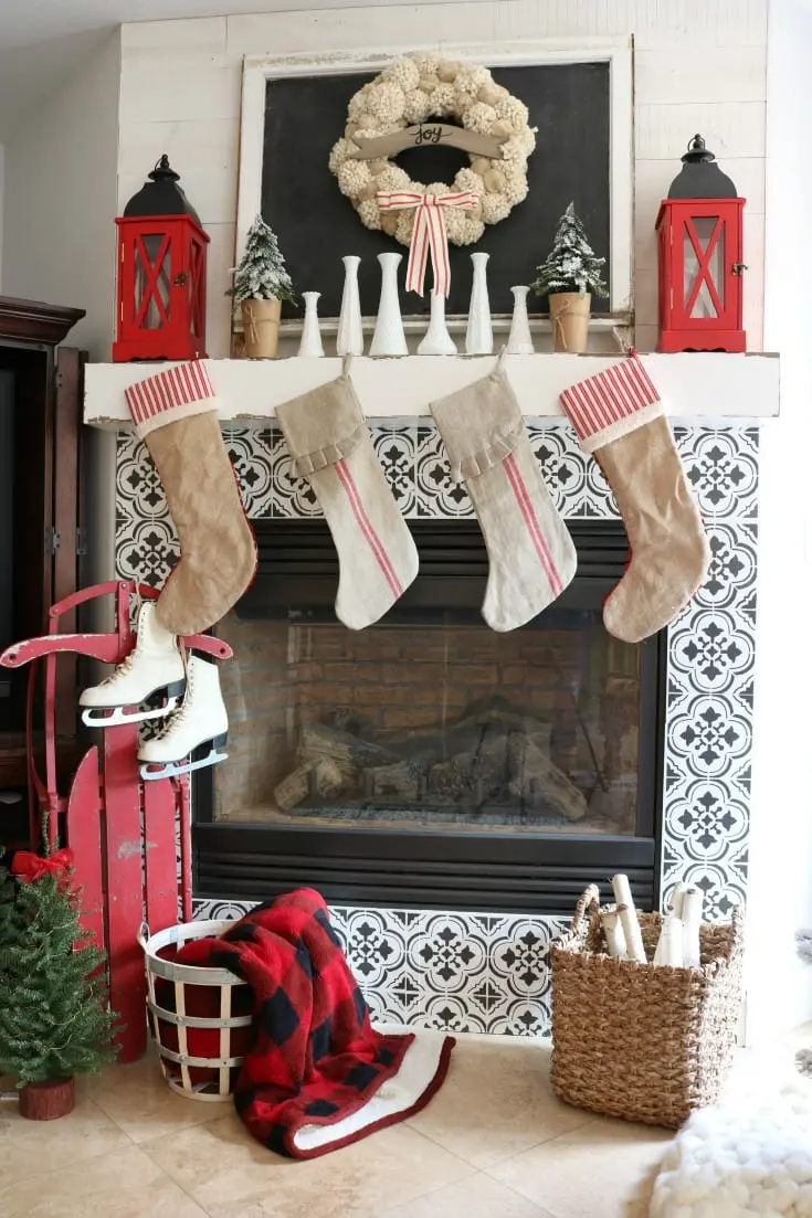 Enjoy my festive buffalo check Christmas Home Tour, complete with how-to's, inspiration, decorating tips, and plenty of sources to create holiday magic in your own home. Enjoy savings coupons to shop beautiful Christmas decor. #christmashome #christmashomedecor #festiveholidayhome #fireplace #thedesigntwins