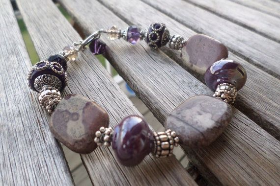 Shades of purple bracelet with stones and Jesse James beads.