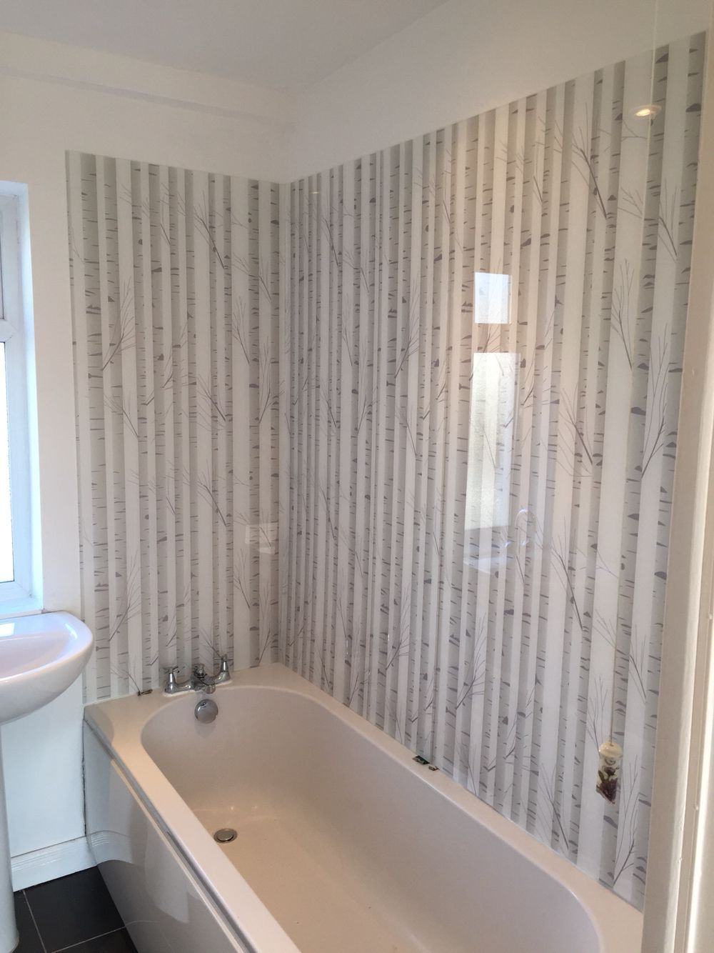 Acrylic shower u bath panels in uwoodland silhouetteu design by