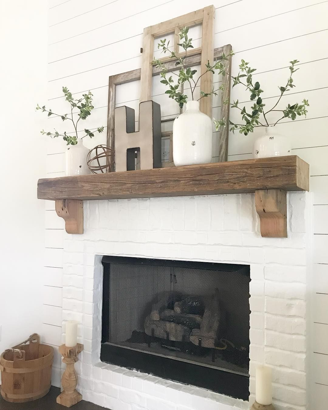 White brick shiplap and chunky mantle for the win on our fireplace