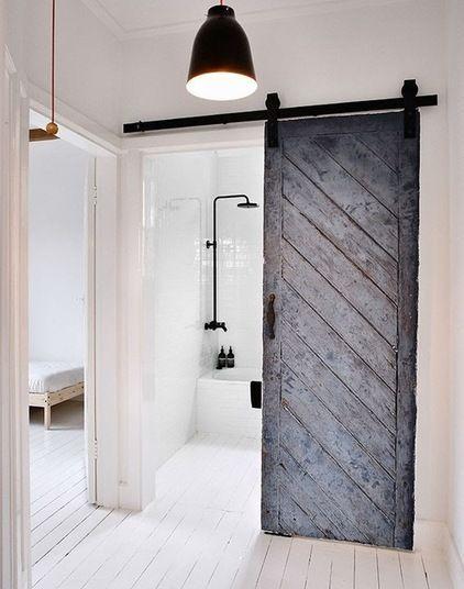 Bathroom Dark Charcoal Grey Sliding Barn Door On Black Rail White Floorboards White Walls In 2020 Minimalism Interior Home Old Barn Doors