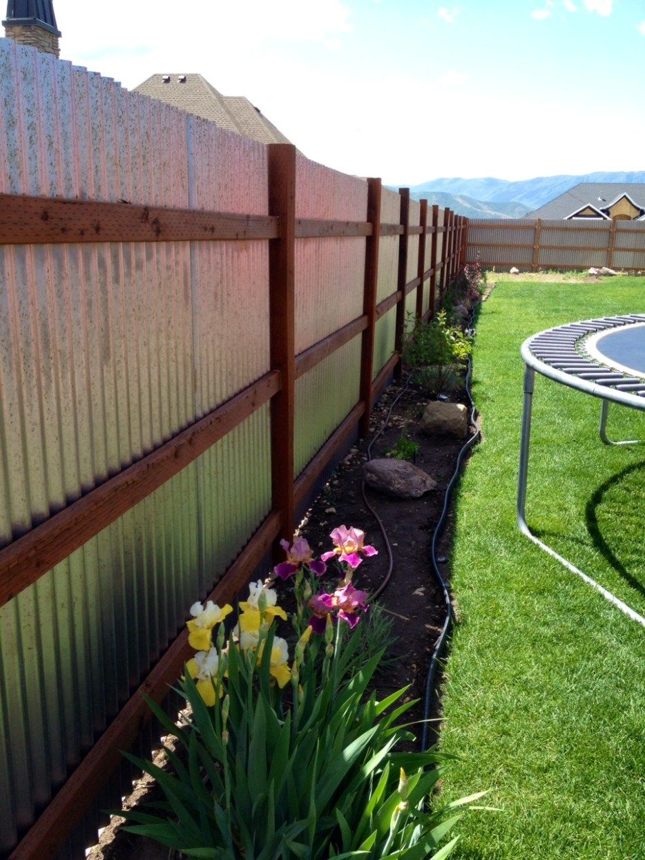 The Progress On My Corrugated Metal Fence Design And How To Build It With Wooden Posts And Rails Also Using Tin Backyard Fences Backyard Privacy Fence Designs
