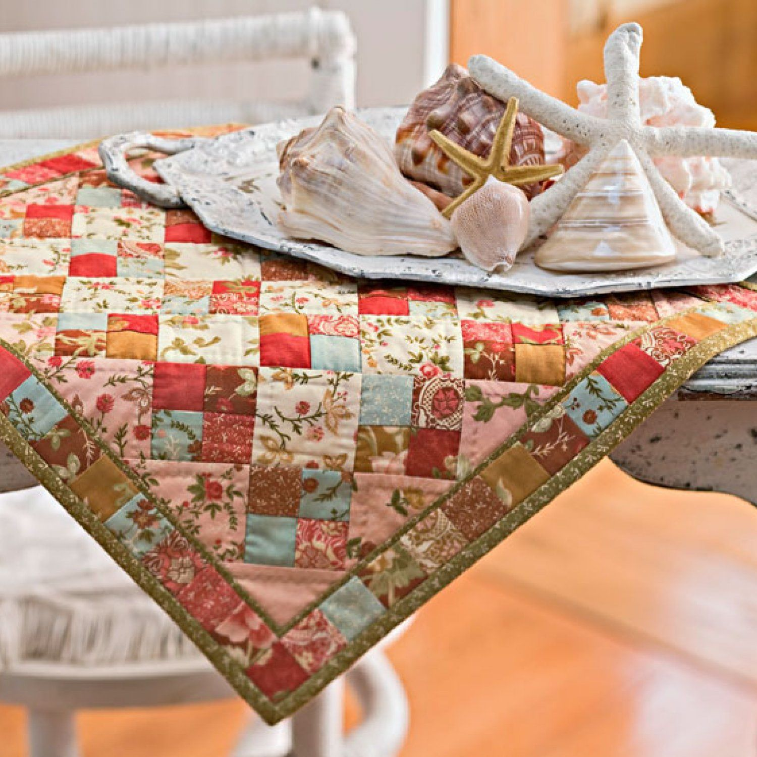 The recipe for this table mat is simple—just mix together a batch of charm squares with two fat quarters.