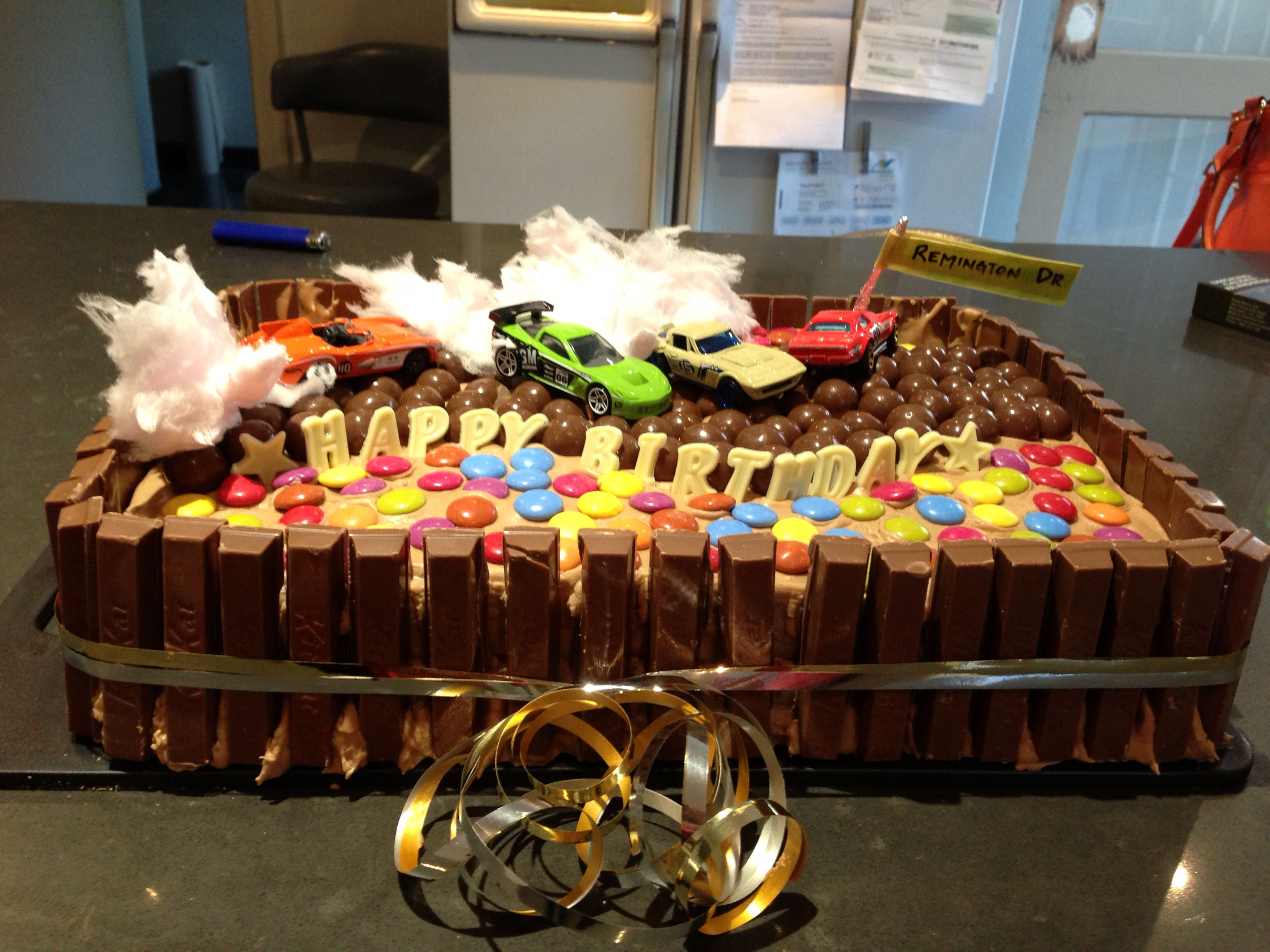 Racing car drifting cake malteasers kit Kats chocolate and ribbon