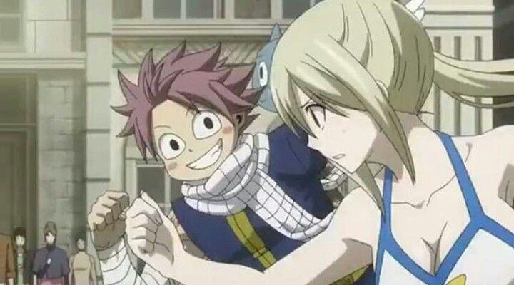 Natsu and lucy ROFL because of Natsu's face xDDD