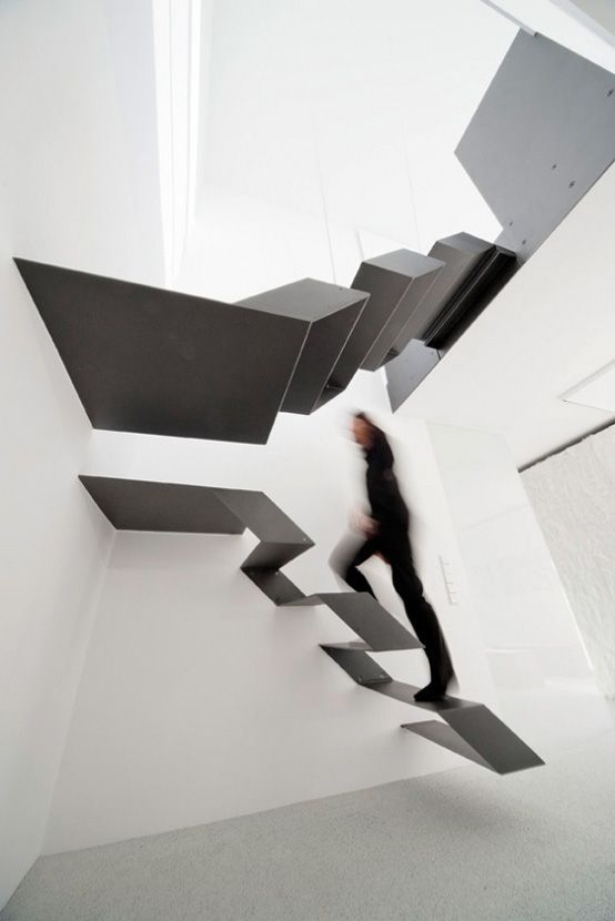 This black and white floating staircase is located in Büro.Loft F27 designed by Schlosser + Partner.