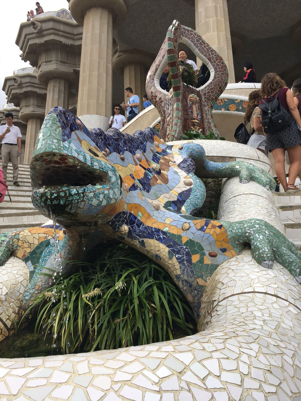 the colorful salamander is sitting at the entrance of gaudi s park