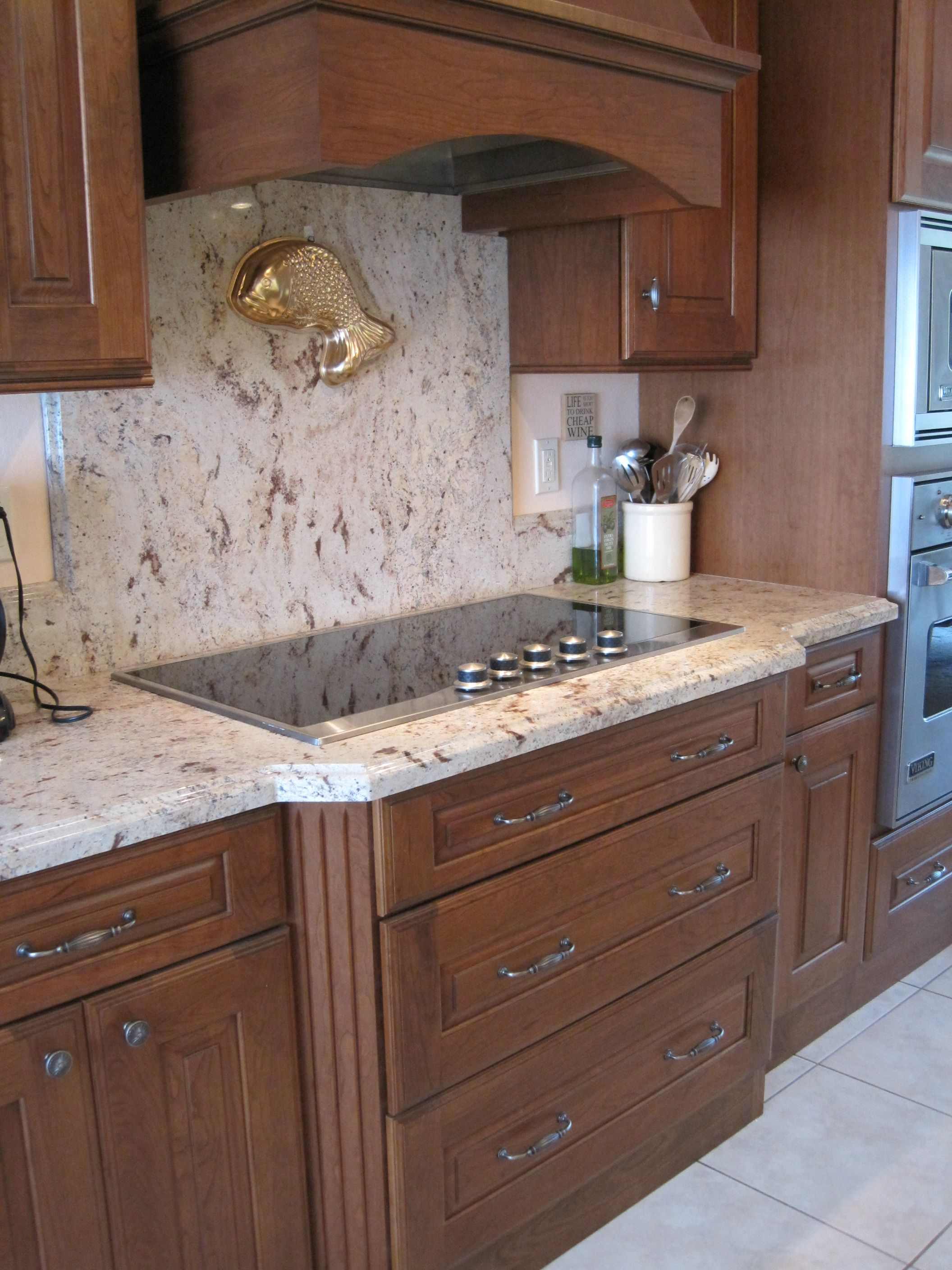 - Granite Backsplash, Full Height, Behind The Cooktop. Granite