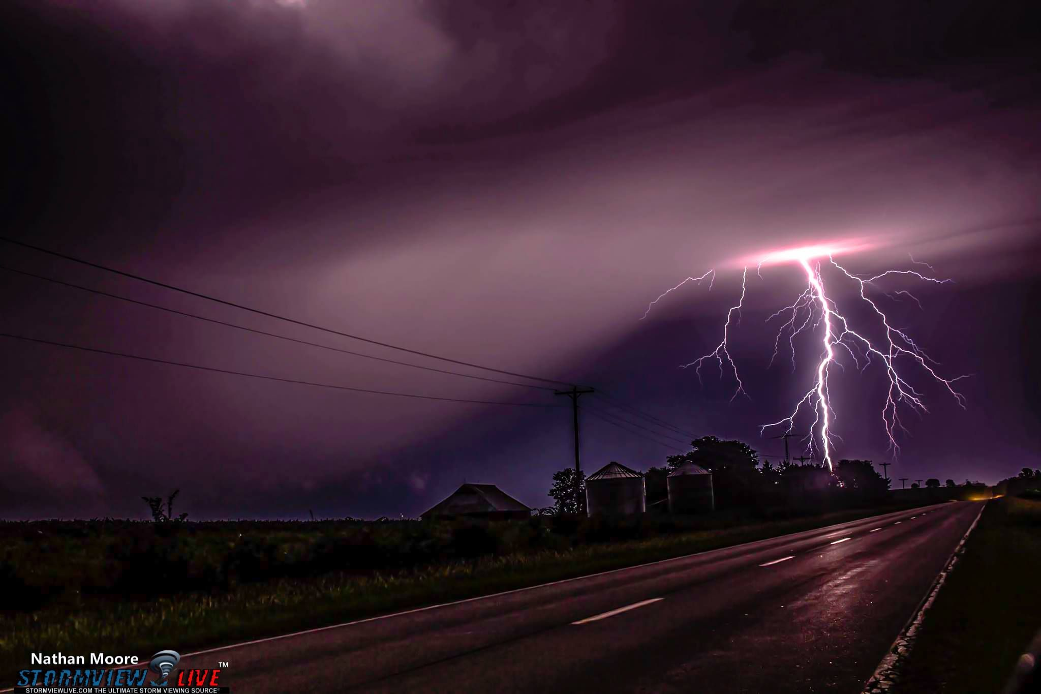 Ok so today's photo is from Elk Creek, Nebraska August 8th, 2015. There were multiple tornado warnings this night and this storm I was on was a confirmed tornado. Sadly there is no way for me to confirm this is the wedge but something is going on there most likely just a really low wall cloud. You can be your own judge. Considering it was dark as dark can be I want to thank this beautiful bolt for lighting everything up for me.