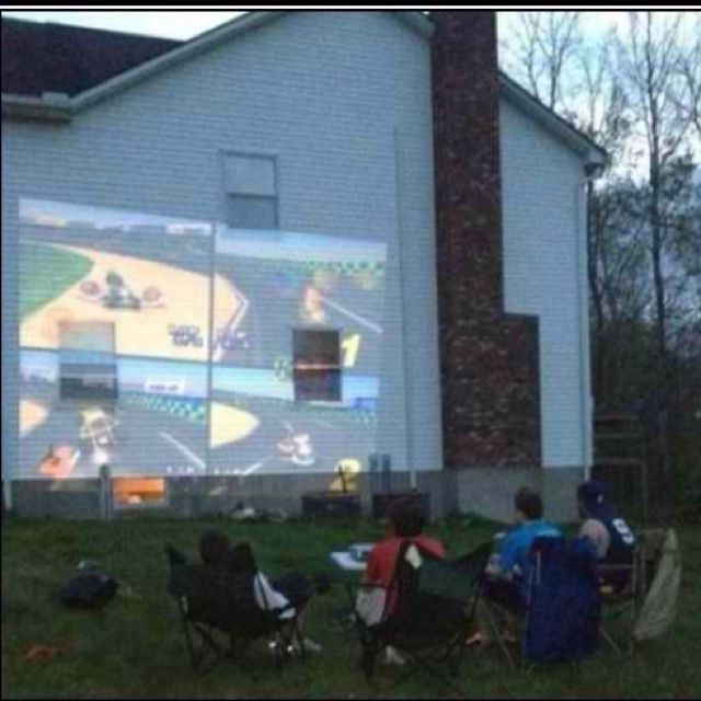 IF I HAD A GOOD ENOUGH SPOT ON MY HOUSE AND A GOOD PROJECTOR I WOULD TOTALLY DO THIS