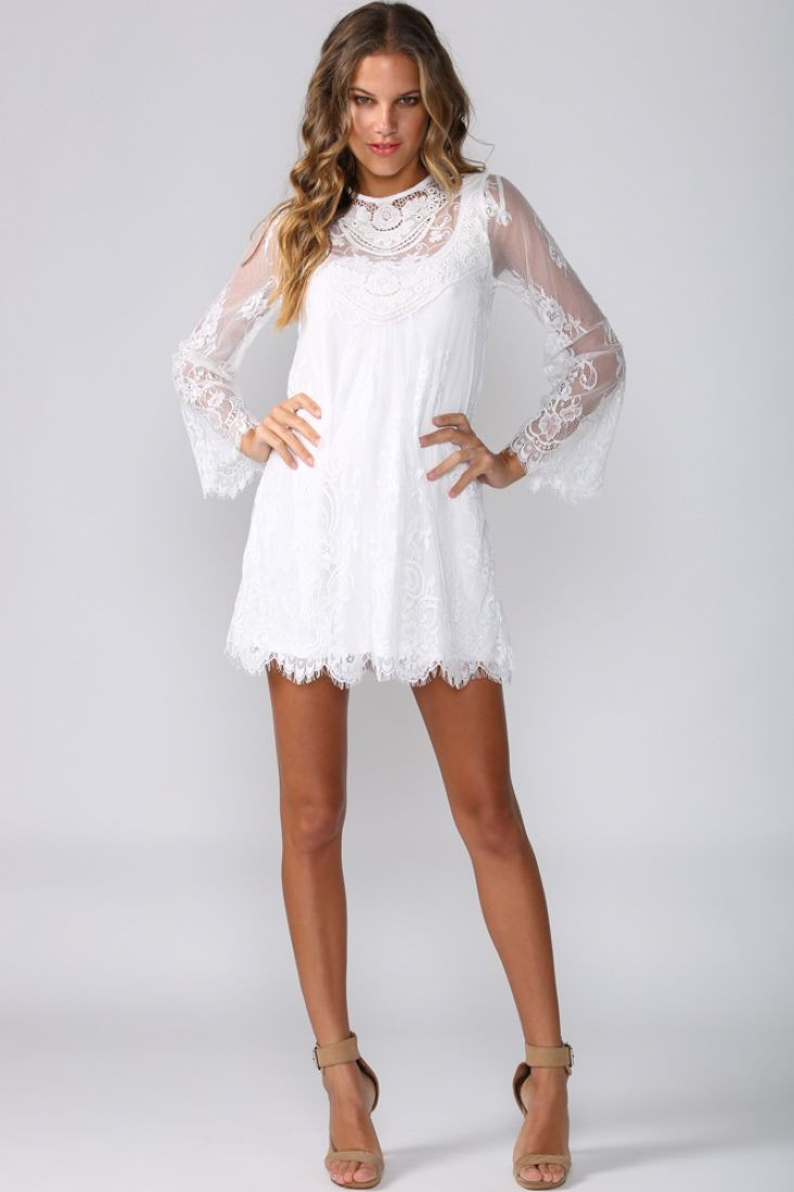 68831653c0e Long-sleeved white dress. Lace detailing. Sheer long sleeves. Inner lining.  Flowy fit. Invisible back zip. Polyester.