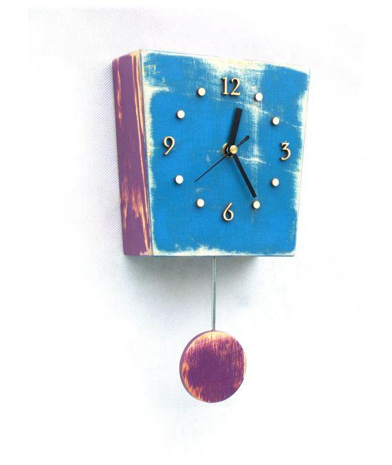 Wall clock with pendulum by ArtmaStudio on Etsy, $55.00