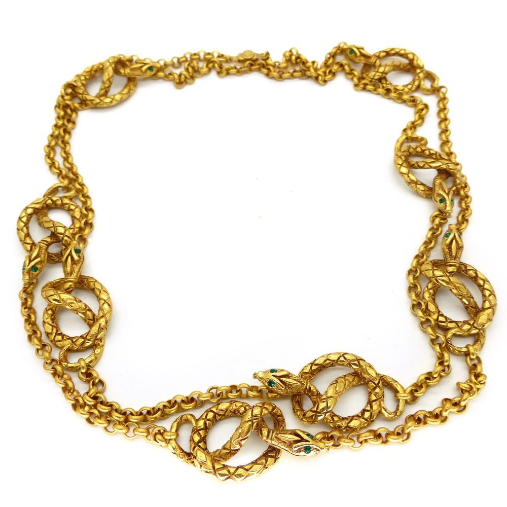 Description a fun necklace featuring beautifully detailed gold metal