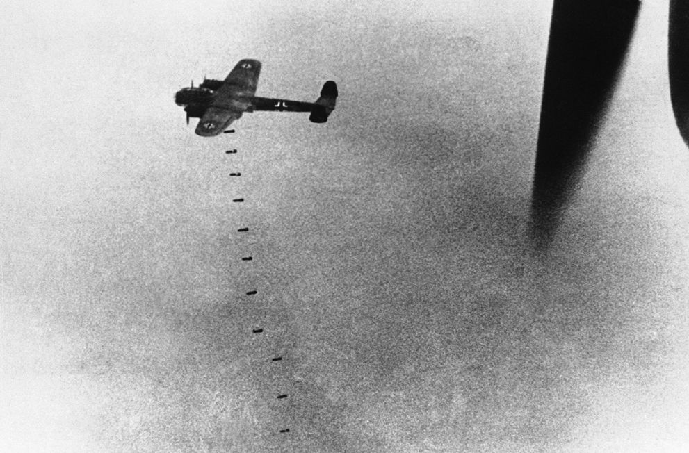 31 A German aircraft drops its load of bombs above England, during an attack on September 20, 1940. (AP Photo) #