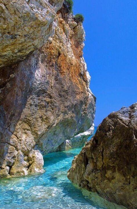 Turquoise water pelion rocks Greece