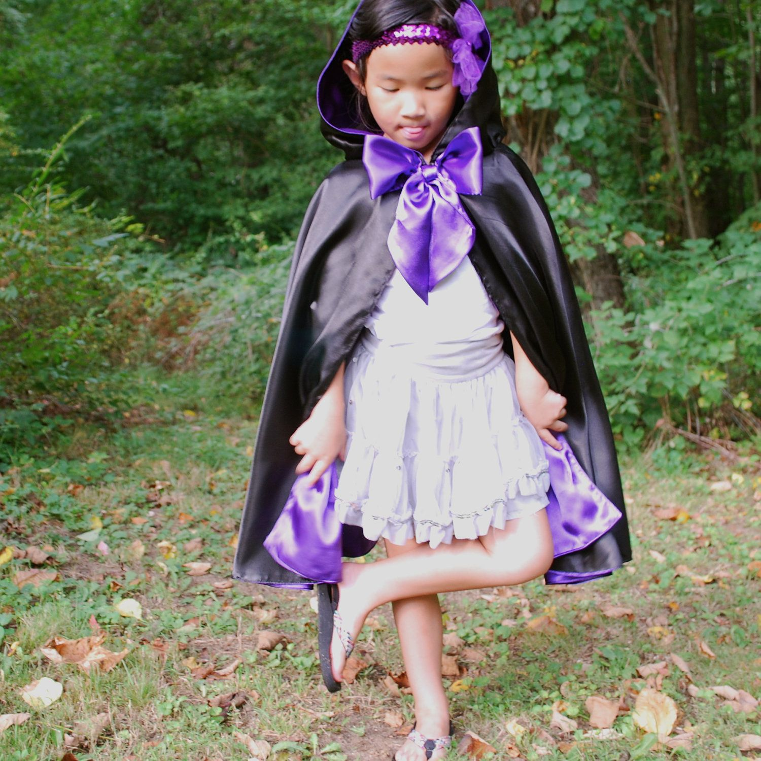Girls Cloak, Black and Purple. $36.00, via Etsy. love this girly version of a magician cape