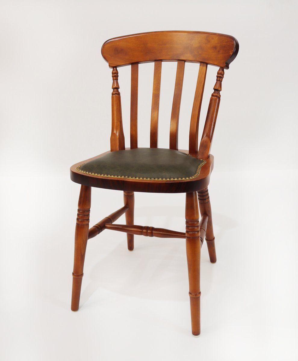 Farmhouse slatback with an upholstered studded seat