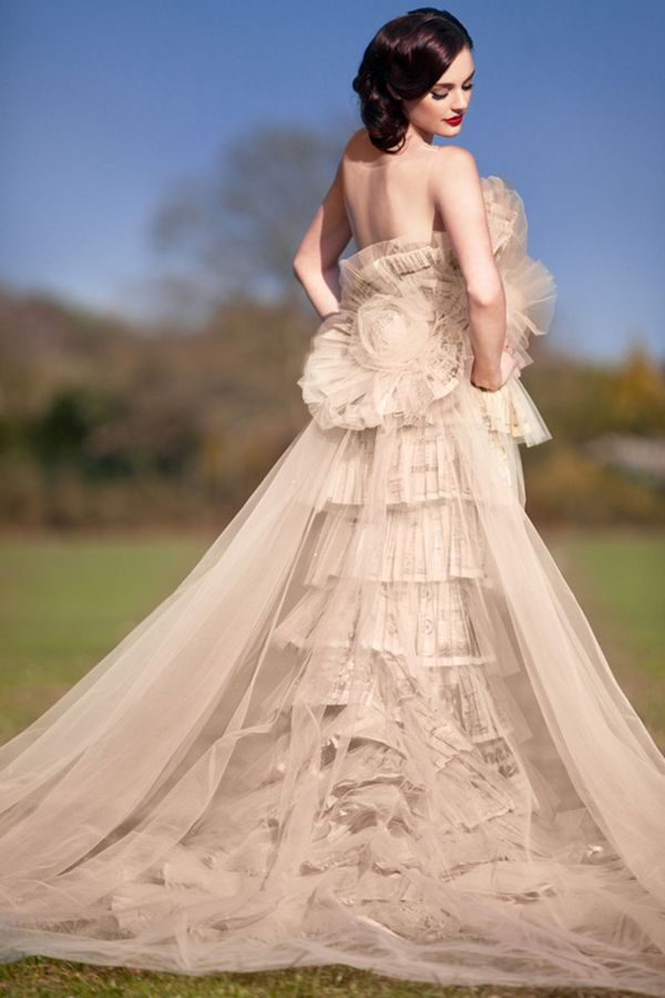 Sanyukta Shrestha: Wallis in Love Collection. So beautiful and romantic couture gown.  Bone lace ruffles under tulle train.  Tulle large flower shapes at bodice and waist.  Fantasy dress!