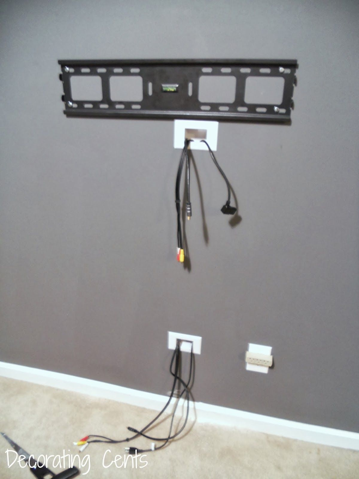 decorating cents wall mounted tv and hiding the cords home rh pinterest com running tv wiring behind wall tv wires behind wall kit