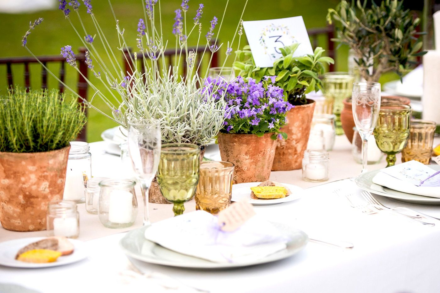 Simple terracotta pots filled with garden plants for a Tuscan Wedding Table dressed for celebration.