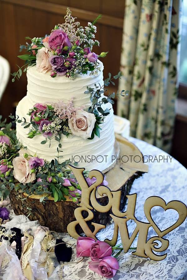 Bohemian Wedding Cake Cake Flowers Pink And Purple Roses Rustic