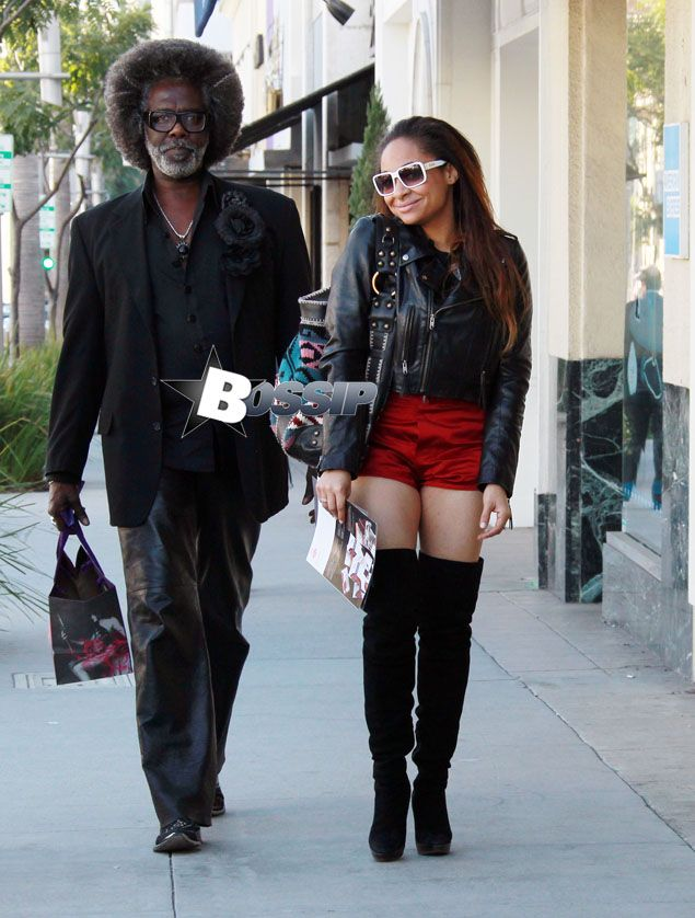 Raven-SymonÌ?å© wearing a red short and black boots went shopping with mom and a friend in Beverly Hills after lunch.