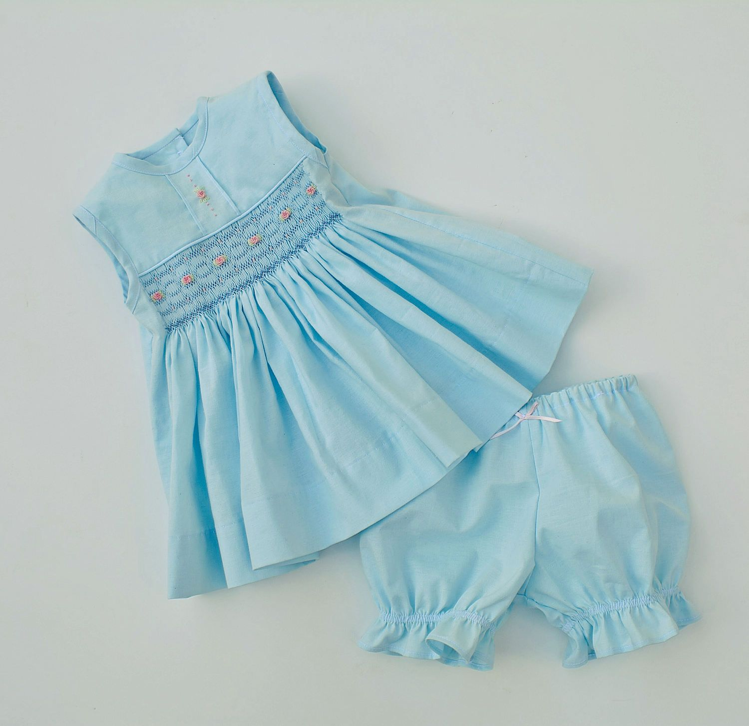 812c32126fc Pale blue smocked dress size 3-6 months with bloomers. Geometric smocking  features pink bullion roses across the front. by TheSmockingMomma on Etsy