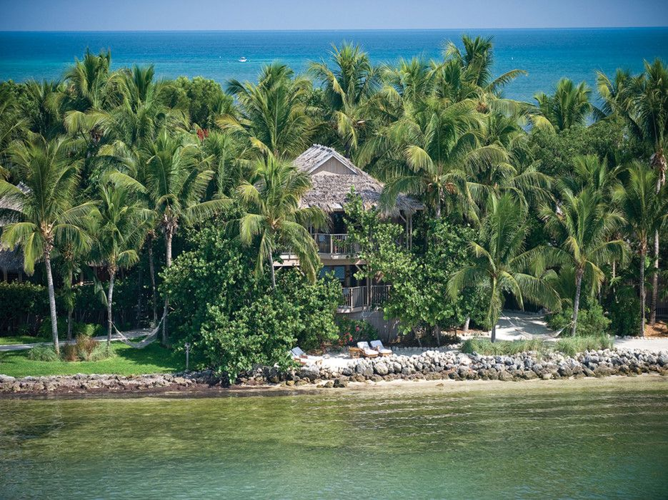 Guests can only arrive here by seaplane or boat—it's a private island, after all. The seclusion is a big part of the resort's draw, along with 30 thatched-roof bungalows tricked out with four-poster beds, claw-foot bathtubs and outdoor showers.