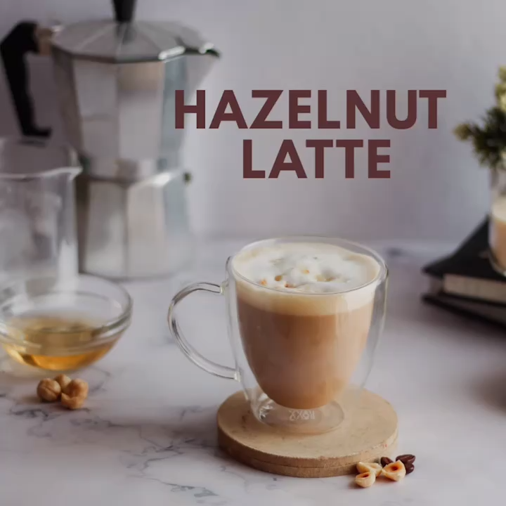 How to make Hazelnut Latte at Home #espressoathome Here's a quick recipe of Hazelnut Latte at home.  Ingredients: Hazelnut Syrup, Espresso / Strong Coffee, Steamed Milk,Foam and toasted hazelnut. #HowtomakeCoffeevideo #HowtomakeHazelnutLatte #Howtomakecoffeeathome #Thewickedsoul #COffeevideo #Recipevideo #espressoathome How to make Hazelnut Latte at Home #espressoathome Here's a quick recipe of Hazelnut Latte at home.  Ingredients: Hazelnut Syrup, Espresso / Strong Coffee, Steamed Milk,Foam and #espressoathome
