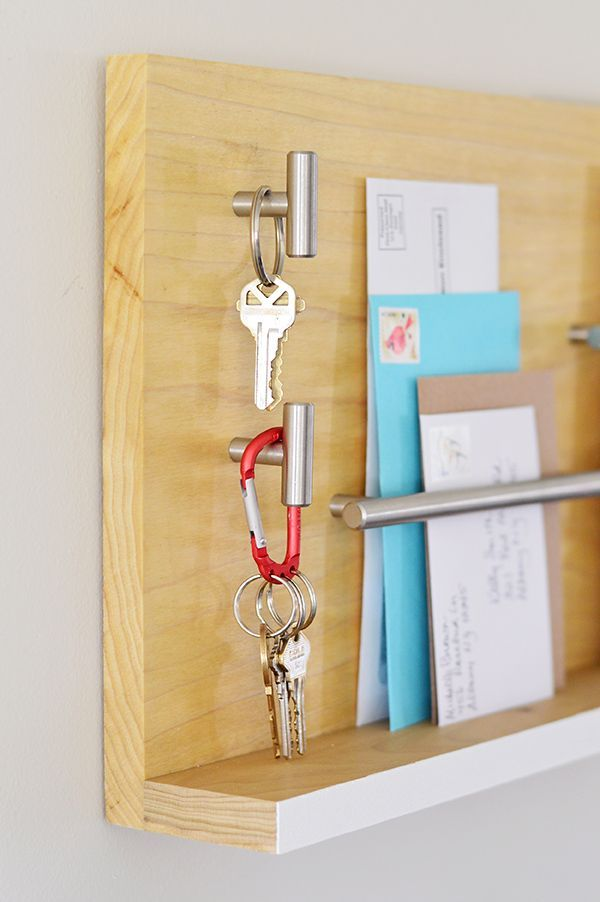 This sleek wall mail organizer and key