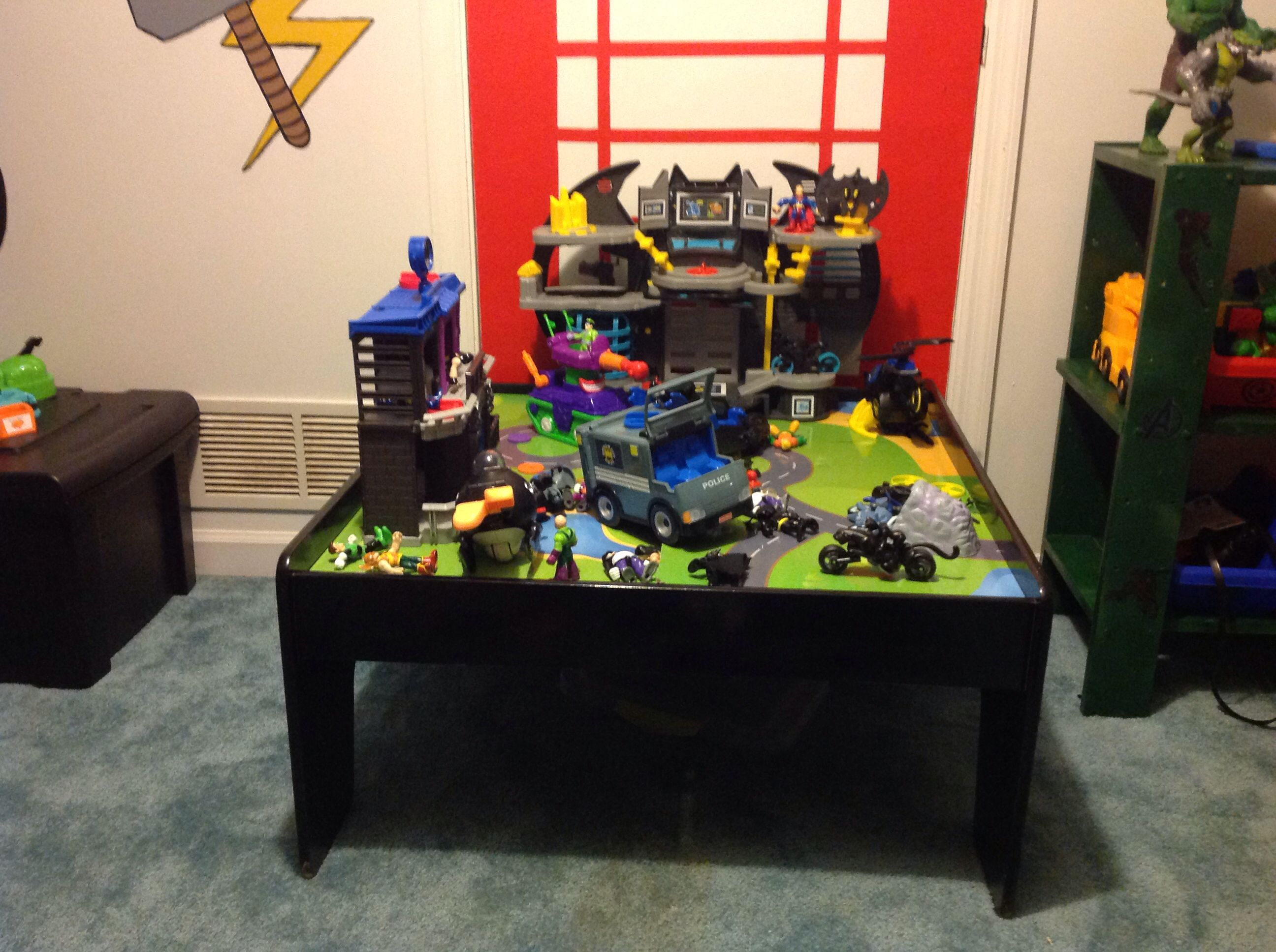 Repurposed his train table into an area for his dc figures!