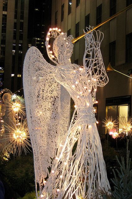 Nyc rockefeller center channel gardens during the holidays lighted angel in christmas outdoor lighting mozeypictures Image collections